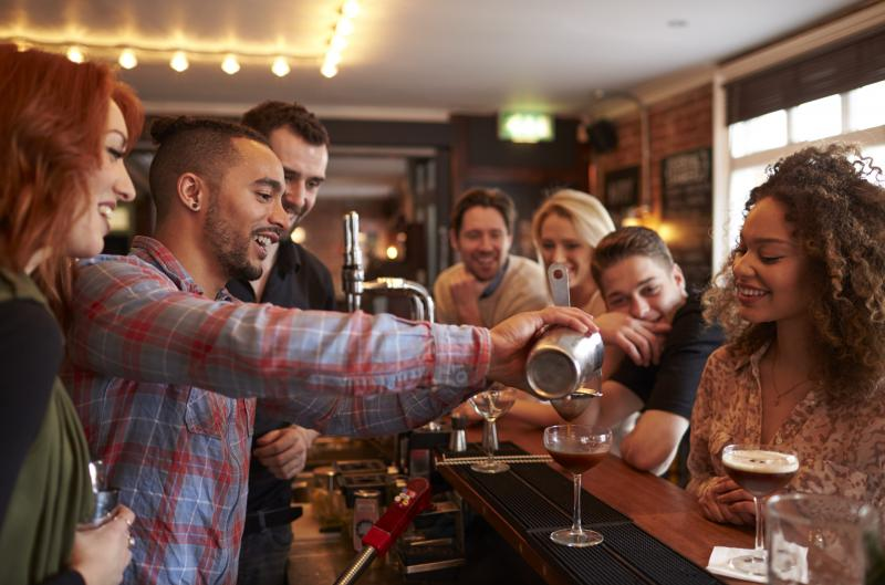man learning how to mix cocktail at lesson in bar